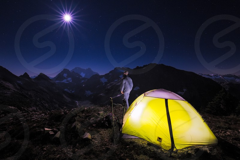night isolated backpacking tent camping mountains photo