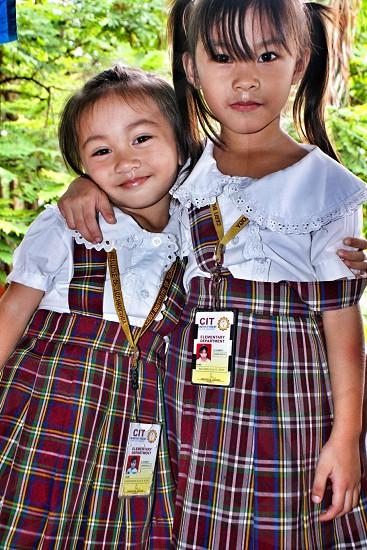 Bestfriends best buddies simply sisters in school uniform photo