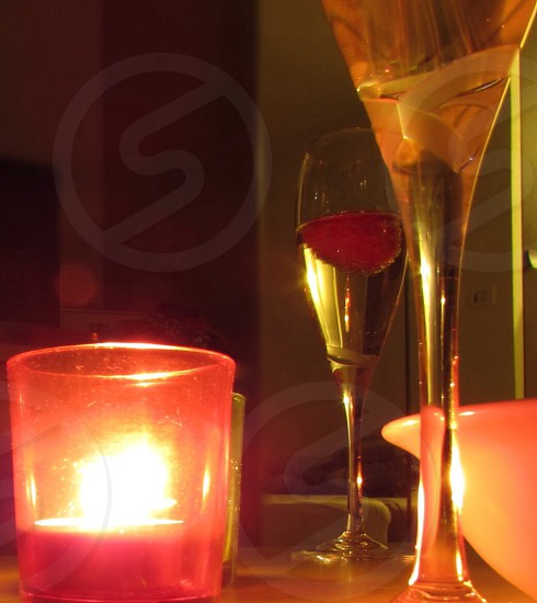 champagne glasses and tea light candle photo