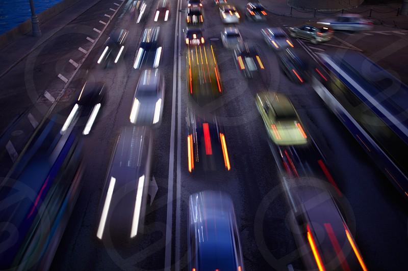 Car traffic at night. Motion blurred background. Long exposure shot. photo