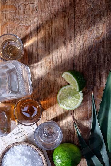 Tequilalimeagave leafMexicomapdrinksaltbottlespiritsalcoholshot glassfood and drinkcover shot photo