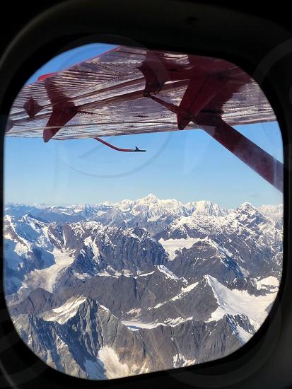 Window flight mountains wing blue skies fly framed Denali National Park Alaska Denali range  photo