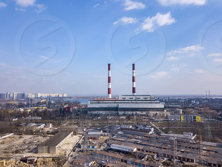 Panoramic view of Electric utility Company in an industrial zone on a background of clear blue sky. Aerial view from drone city Kiev Ukraine. photo