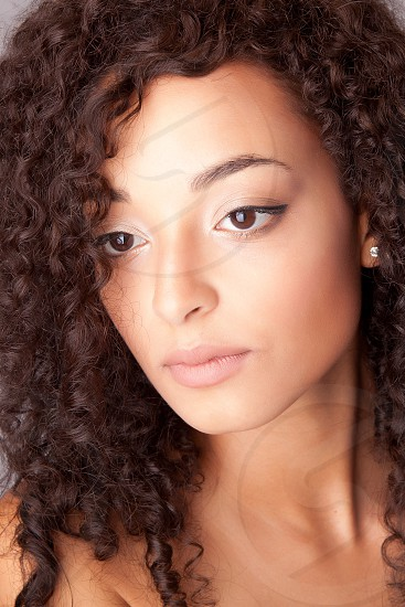 Woman serious expression nude naked african afro curly hair brown eyes beauty skin photo