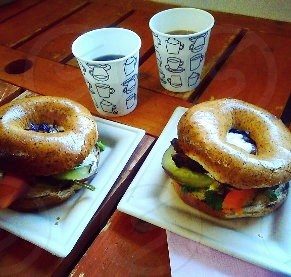 two cooked burger on white ceramic plate photo