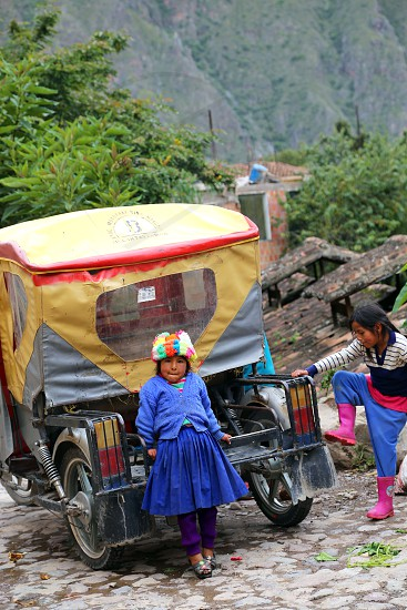 Peruvian girls playing in the street photo
