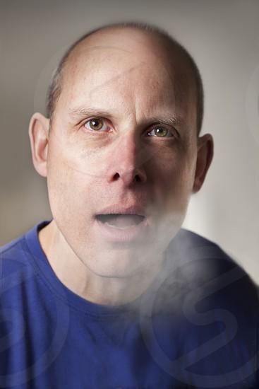 man in blue shirt  photo