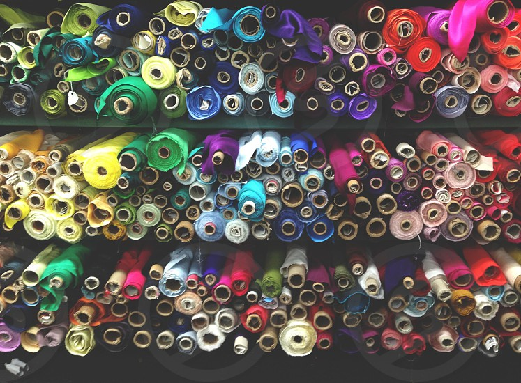 multicolor bolts of fabric photo