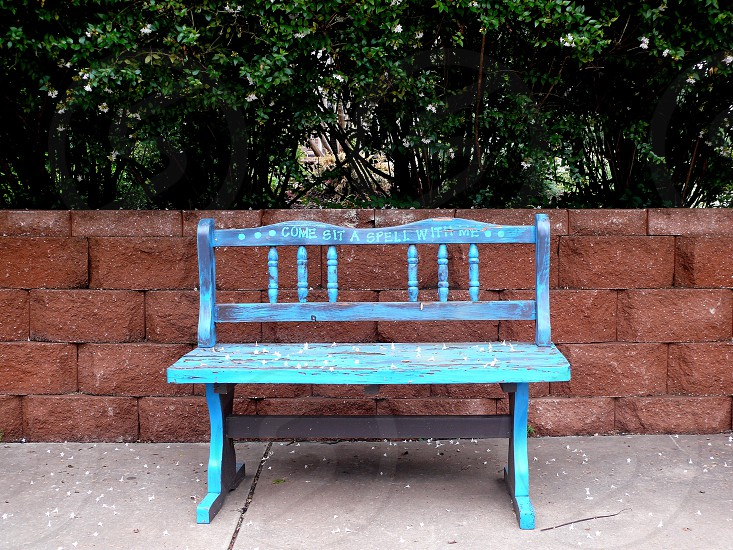 blue bench seat things with writing  photo