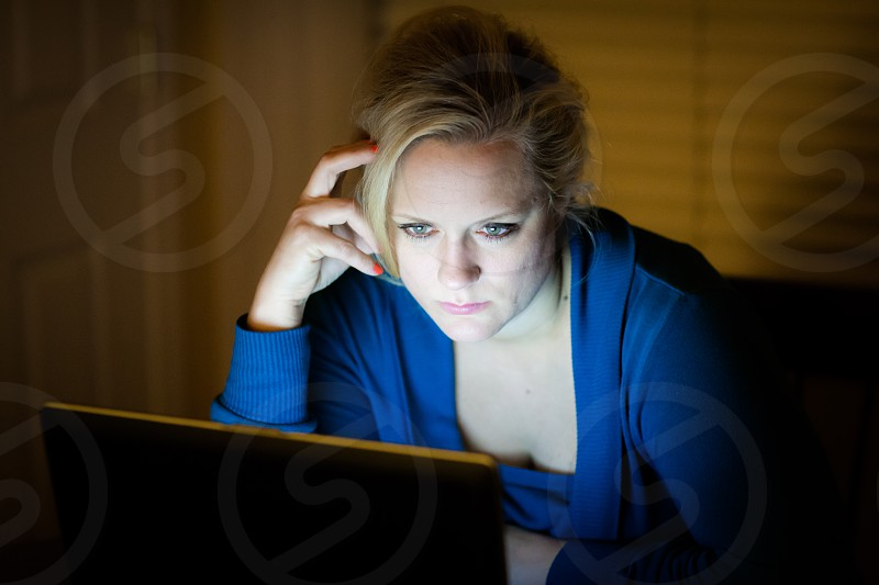 Girl in blue frustrated over email photo