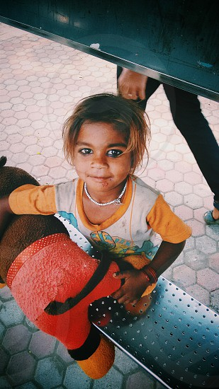 well this beauty? doesnt she look cute? this sweet lil kid with beautiful eyes and dreams in it❤ photo