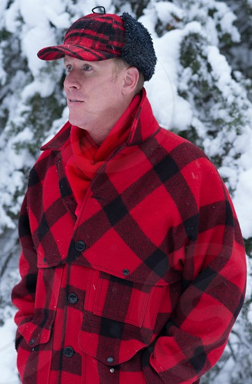 Man In Buffalo Check Jacket and Hat photo
