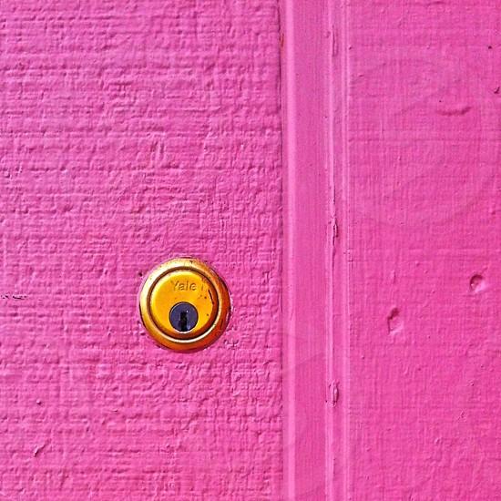 Pink wall keyhole photo