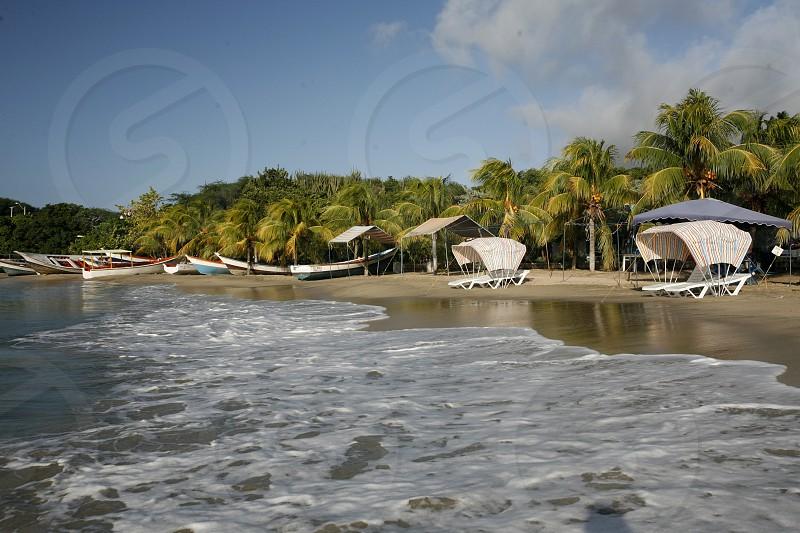 the beach Playa Pedro Gonzalez in the town of Pedro Gonzalaz on the Isla Margarita in the caribbean sea of Venezuela. photo