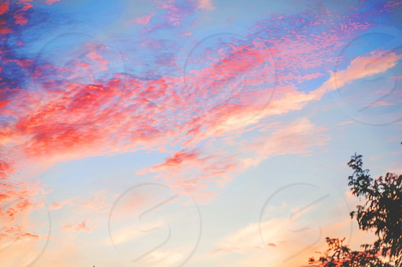 sunset skies with clouds photo