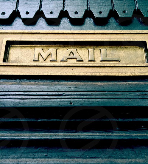 Mail slot on a colorful door.  photo