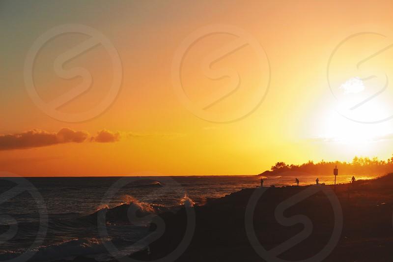 Oahu island Hawaii fishing fisher sunset ocean sea waves surf paradise golden hour  photo