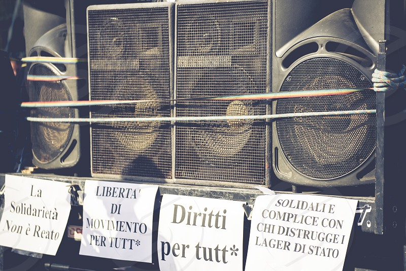A wall of audio speakers and Italian anti-racist slogans photo
