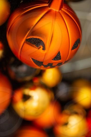 Halloween holiday decorative ornamental balls featuring a jack-o'-lantern. photo
