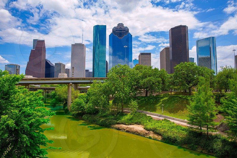Houston Texas Skyline with modern skyscapers and blue sky view from park river US photo