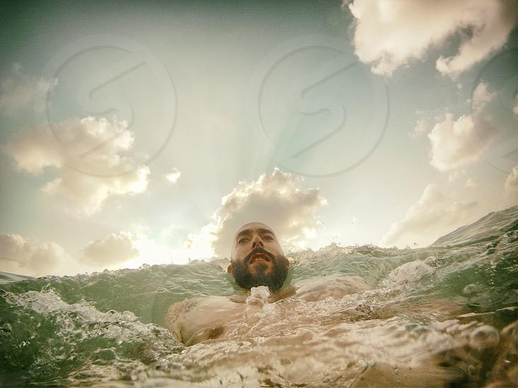man swimming photograph photo