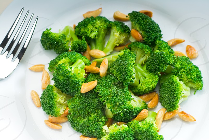 fresh and vivid sauteed broccoli and almonds very ealthy food photo