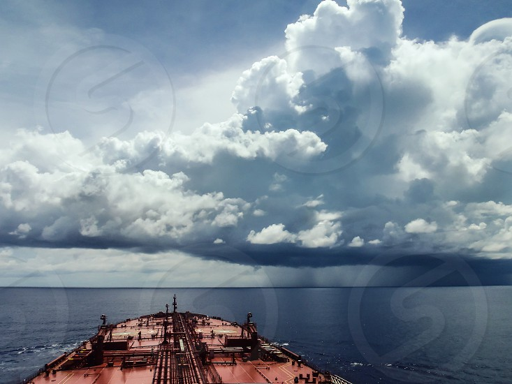 An oil tanker sails in the waters of Indian ocean while a terrible storm is upcoming photo