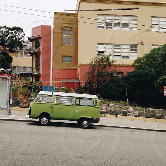 green white and black volkswagen vb bus near curb photo