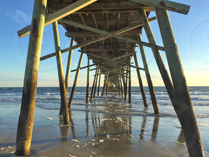 A fishing pier just out into the ocean Atlantic Beach North Carolina photo