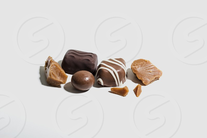 chocolate; pieces; chocolates; white background; food; sweet;  photo