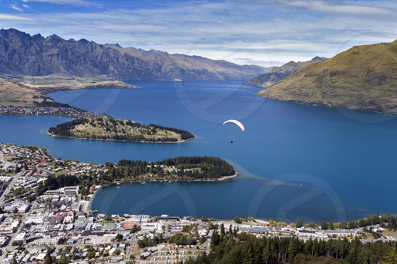 new zealand queenstown paragliding skydive view tandems blue sky gliding aerial hang nature extreme landscape sport fly mountain adventure nz parachute air recreation freedom island glide outdoor tourism vacation scenic jump attraction skydiving south high tandem spectacular skyline gondola photo