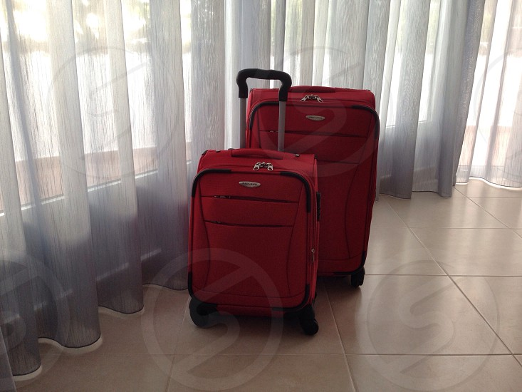 red trolley bag photo