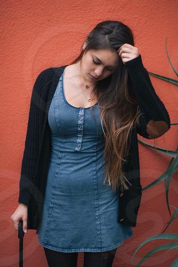 woman wearing black cardigan standing photo