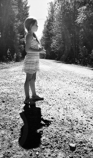 Gravel gravel road girl child daughter summer bw photo
