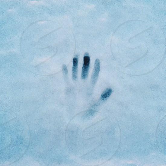hand print on snow photo