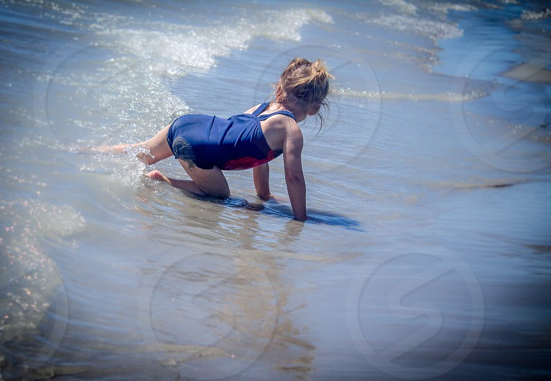 girl sand beach water bear lake relaxing sublime cool shadow travel vacation sunshine wet summer fun photo