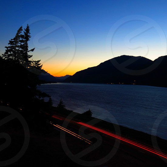 The Columbia River with passing cars. photo