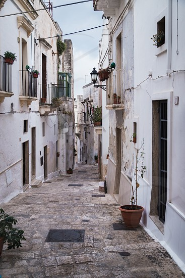 Grottaglie Italy - August 2019: Historic center of Grottaglie in Puglia during a morning in August photo