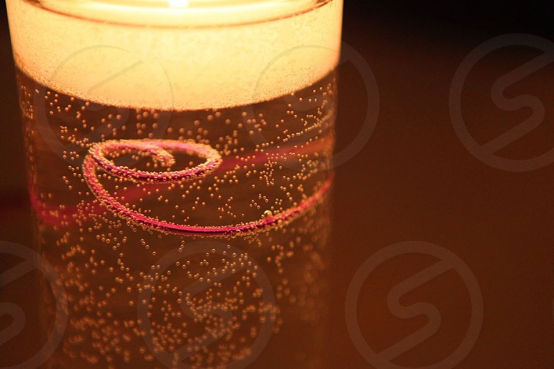 close up photography of beverage drink on glass with red strings photo