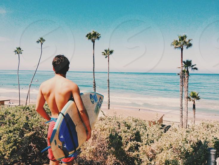 man holding surfboard photo