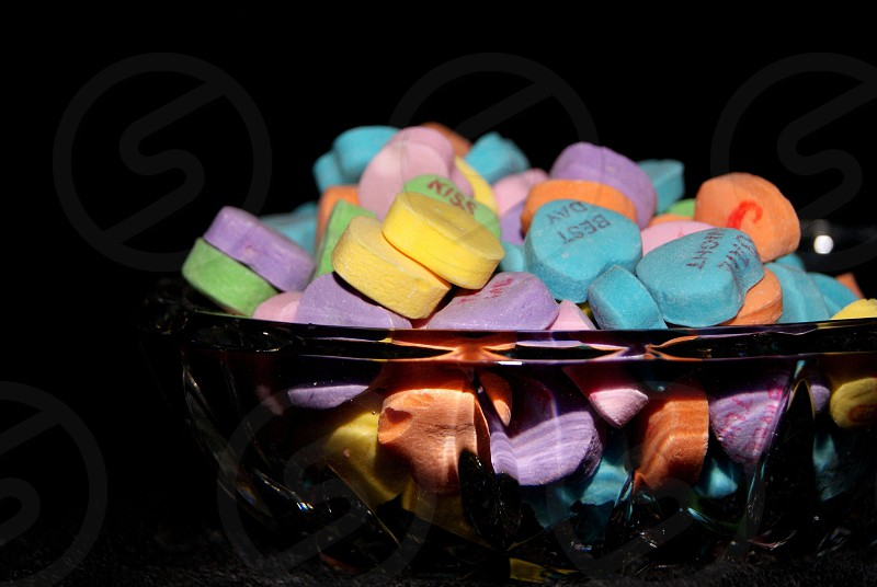 Crystal dish full of conversation hearts for Valentines day photo