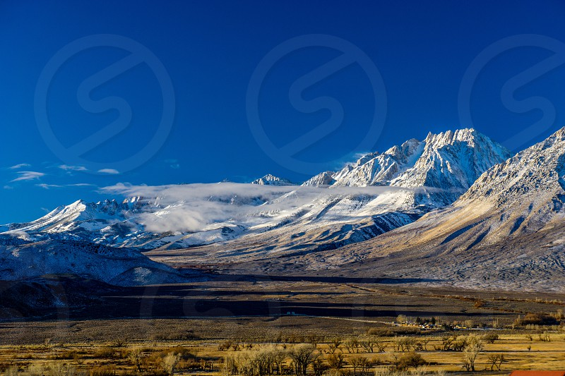 MountainssnowcloudslandscapescenicwinterSierra NevadahillsSkyvalleyBishopCalifornia  photo