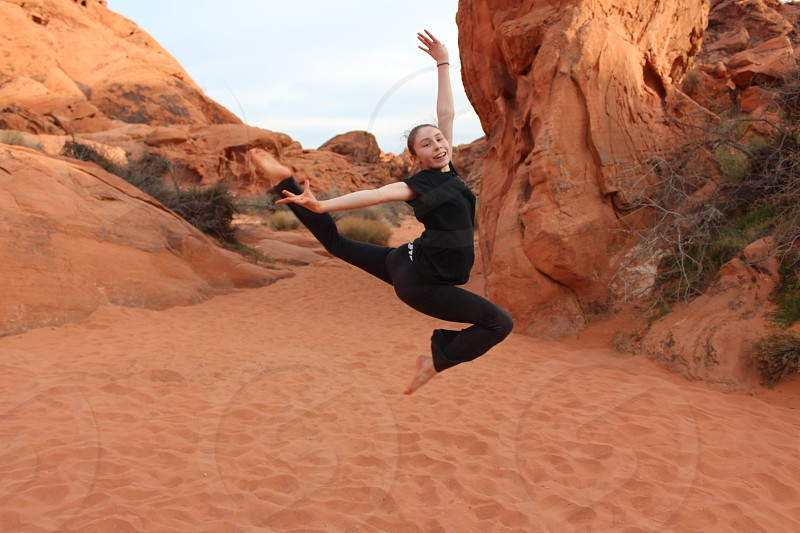 Young gymnast performing a stag jump in Valley of Fire State Park photo