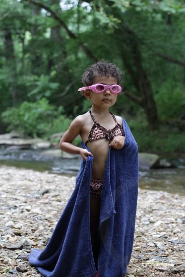 girl holding blue bath towel photo