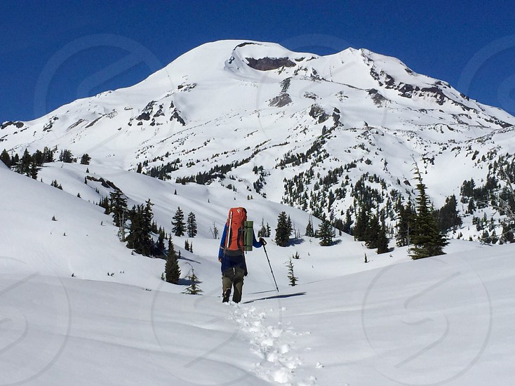 Mountain snow backpacking backpacker winter hiking man solo alone Oregon adventure photo