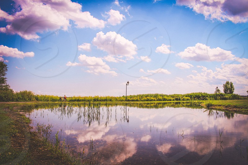 Head in the clouds. Beautiful reflection in the river taken in montreal verdun Canada. photo