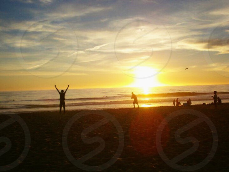 Happy living beautiful life at beach golden hour photo