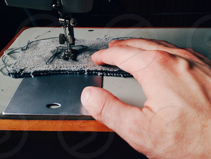 person sewing in sewing machine photo