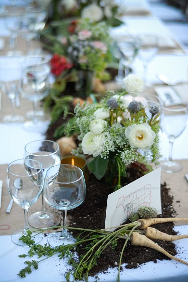 bouquet of flowers near wine glasses on table  photo