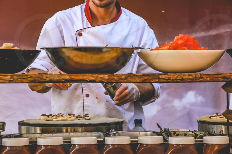 chef making banana and chocolate crepes photo